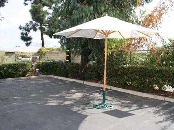 Where to find 9  MARKET UMBRELLA NATURAL W BASE in Orange County